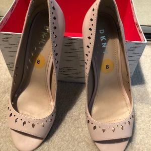 Blush color open toed pumps.